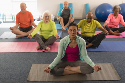 senior people doing yoga