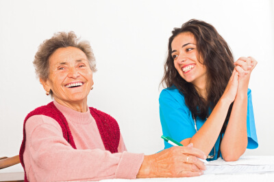 happy senior woman with her caregiver