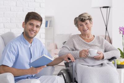 smiling elegant senior woman with caregiver